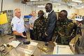 From right to left, U.S. Air Force Chief Master Sgt. Doug Faldet and Airman 1st Class Alisha Milander escort visiting African dignitaries Warrant Officer Abass Akesse from Ghana, Capt. Bachirou Amadou from Togo 120813-Z-WA217-132.jpg