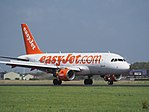 G-EZAX easyJet Airbus A319-111 landing at Schiphol (EHAM-AMS) runway 18R pic2.JPG