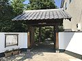 Gate of Denshoji Temple near Tojinmachi Station.jpg