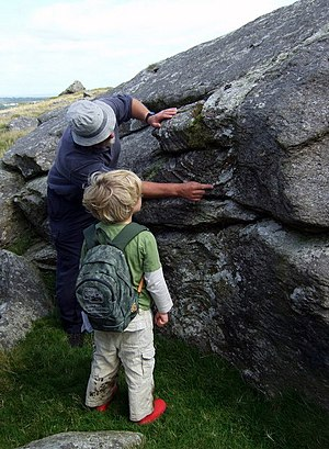 Geologist - A young geologist learns about flow banding