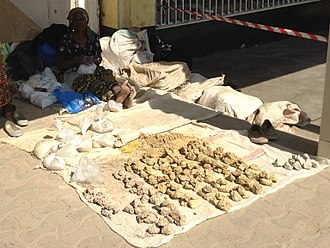 Geophagia - Several different rocks of clay-like material being sold at a local market in Kabwe, Zambia. These are usually purchased and consumed by pregnant women.