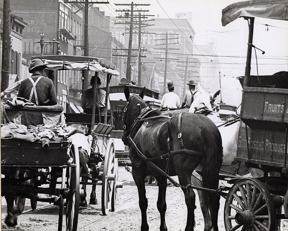George Bosche Produce Company wagon pulling out into traffic on Broadway near the corner of Cerre Street
