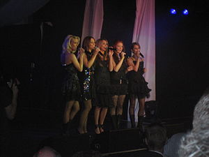 Cheryl (entertainer) - Cheryl (far right) with Girls Aloud performing at the Capital Radio Help a London Child fundraiser, 2005.