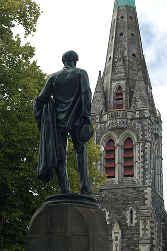 Godley Statue - Godley Statue in 2005 in front of the ChristChurch Cathedral. The tower in the background was demolished after the 2011 Christchurch earthquake.