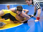 A near fall can also be scored when the defensive wrestler is held with one shoulder on the mat and one shoulder at an angle of 45 degrees or less toward the mat, as shown.