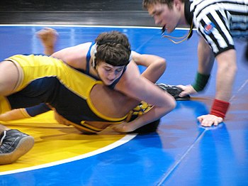 A near fall can also be scored when the defensive wrestler is held with one shoulder on the mat and one shoulder at an angle of 45 degrees or less toward the mat, as shown. Going in for the pin!.jpg