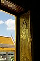 Gorgeous gold-painted doors at Wat Traimit.jpeg