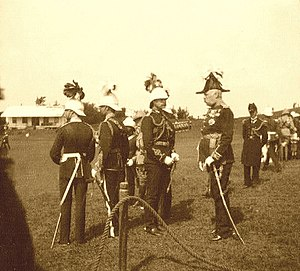Governor of Bermuda - Governor Lt. Gen. Sir Henry LeGuay Geary, KCB (right), at Prospect Camp, Bermuda, on Tuesday, the 11 March, 1902 to decorate three officers with the DSO