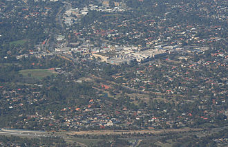 Greensborough, Victoria - Aerial view from the north, Greensborough Bypass just in foreground, Greensborough Plaza in centre of image, and Greensborough railway station to left.
