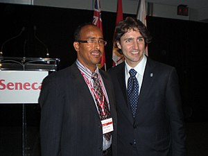 Somali Canadians - Journalist Hassan Abdillahi of Ogaal Radio with then MP Justin Trudeau at Seneca College (2009).