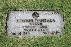 English: Headstone with Buddhist symbol approv...