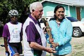 Her Lordship, Mayor Zenida Moya Flowers receives the Queen`s Baton 2010 Delhi from the Commonwealth Games Federation Regional Vice President for the Americas, Mr. John Hoskins, in Belize on April 07, 2010.jpg