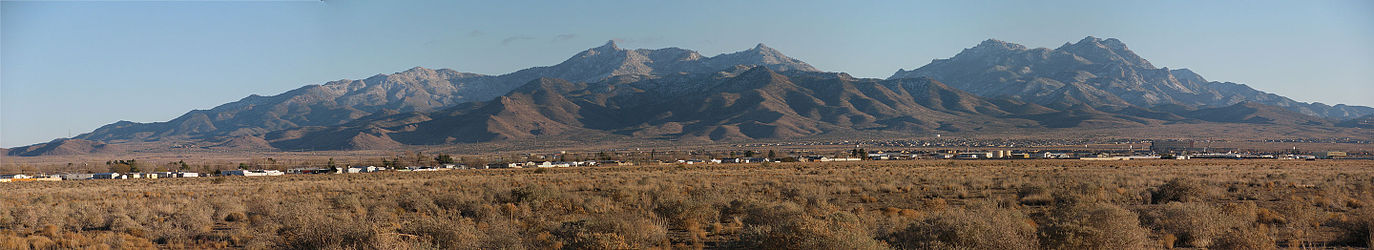A panorama of the Hualapai Mountain range seen from Kingman, Arizona. The photographs were taken in late December and the mountains have a light dusting of snow. The camera location was south of Northern Avenue, east of Bank Street.