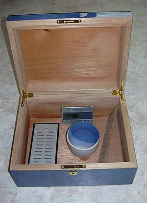 Humidor - Humidor with hygrometer and bowl of water ready to be seasoned