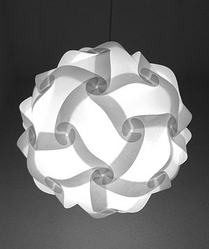 "Rhombic triacontahedron - An example of the use of a rhombic triacontahedron in the design of a lamp. IQ stands for ""Interlocking Quadrilaterals""."