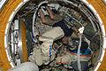 ISS-22 Maxim Suraev works with EVA equipment.jpg