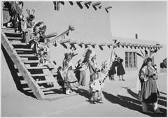 "Indians in headdress, male and female, descending stairs, ""Dance, San Ildefonso Pueblo, New Mexico."", 1933 - 1942 - NARA - 519982.tif"