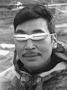 A man wearing Inuit snow goggles