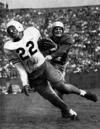 Jimmy Joe Robinson carrying the ball against Notre Dame in 1948 JJRobinson1948vsND Owl49p249.jpg