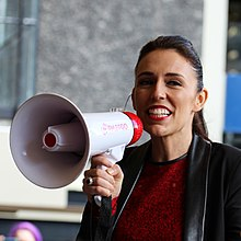 Ardern speaking into a megaphone