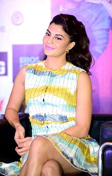 Jacqueline Fernandez smiles away from the camera.