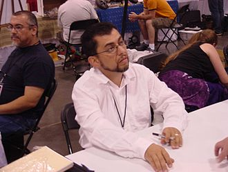 Jaime Hernandez - Jaime Hernandez at Heroes Con 2006. Gilbert Hernandez is visible on the left.