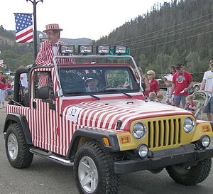 Jerry Haynes - Haynes in the 2007 Red River, New Mexico Fourth of July parade, riding in his trademark Jeep Wrangler painted with candy stripes