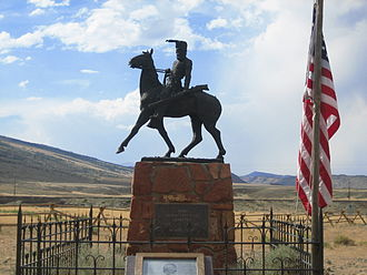 Old Trail Town - Bronze statue of Liver-Eating Johnson erected over his grave at Old Trail Town