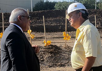 Juan L. Maldonado - President Juan L. Maldonado (left) converses on September 15, 2010, with Jesse Poras, then the incoming LCC trustee, at the groundbreaking of the Rodney Lewis Education and Academic Center. Four years later, Maldonado campaigned successfully to defeat Porras in the trustee elections. Maldonado announced his own retirement several months thereafter.