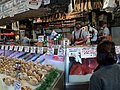 Justin preparing to catch a fish Pike Place Fish Market Seattle.JPG