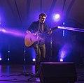 Justinas Stanislovaitis in an acoustic solo performance Vilnius 2017.jpg