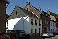 Köln-Stammheim Stammheimer Hauptstrasse 55 Denkmal 3995 dahinter Haus 57.jpg