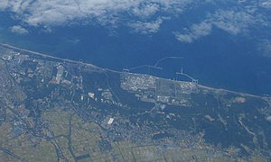 Kashiwazaki-Kariwa Nuclear Power Plant - Aerial view. The breakwaters where seawater is taken from in order to cool waste heat water, can be seen clearly.