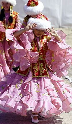 Kazakh girls wear traditional Kazakh costumes.JPEG