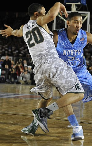 Travis Trice - Trice (left) guards Kendall Marshall in 2011