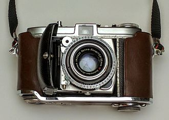 Exposure value - Detail of front of Kodak Retina Ib 35mm camera (c. 1954) showing the EV  setting ring that couples aperture and shutter speed settings.