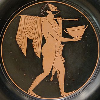 Epiktetos - Komast with a skyphos, a staff and pipes case, tondo from a red-figure plate by Epiktetos, ca. 520s BCE–500s BCE, from Vulci, Cabinet des Médailles (n.510).