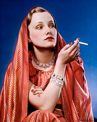 """Girl in Red"" advertisement for Lucky Strike; shot by Nickolas Muray, a photographer enlisted by Bernays to help popularize feminine thinness and cigarette smoking. LUCKY STRIKE, GIRL IN RED.jpg"
