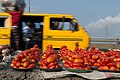 Lagos yellow bus with red tomatoes and blue sky.jpg