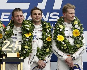 Earl Bamber - Bamber (centre) on the podium following the 2015 24 Hours of Le Mans