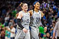Lindsay Whalen and Maya Moore leave the court at halftime.jpg