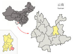 Location o Shilin Coonty (pink) an Kunming prefectur (yellae) athin Yunnan province o Cheenae