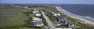 Oak Island Light - Image: Looking East from the lighthouse towards Bald Head Island