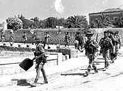 Loyal Edmonton Regiment soldiers entering Modica Sicily July 1943
