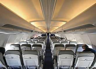 Aircraft cabin - Cabin of a Boeing 737 (Economy class) with typical seating arrangement