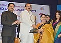 M. Venkaiah Naidu presenting the Mohammad Rafi Award 2017 for life time achievement to music director, journalist and cartoonist, Shri Shrikant Thackeray and his wife, Smt. Madhuvanti Thakeray receiving the Award, in Mumbai.jpg