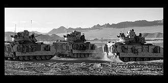 M2 Bradley - Three M2A3 Bradleys exit an OCCD at the start of a Patrol at Fort Irwin, California.