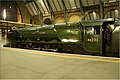 Man and machine at rest, Duchess of Sutherland at London King's Cross. - panoramio.jpg