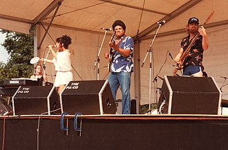 Maria Muldaur - Muldaur (left) with her band on stage at the 1983 Cambridge Folk Festival, U.K.