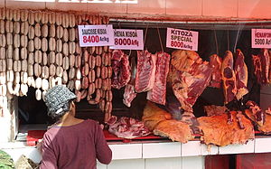 Malagasy cuisine - Meat stall in Antananarivo selling sausages, henan-kisoa (pork) and kitoza (dried or smoked beef)